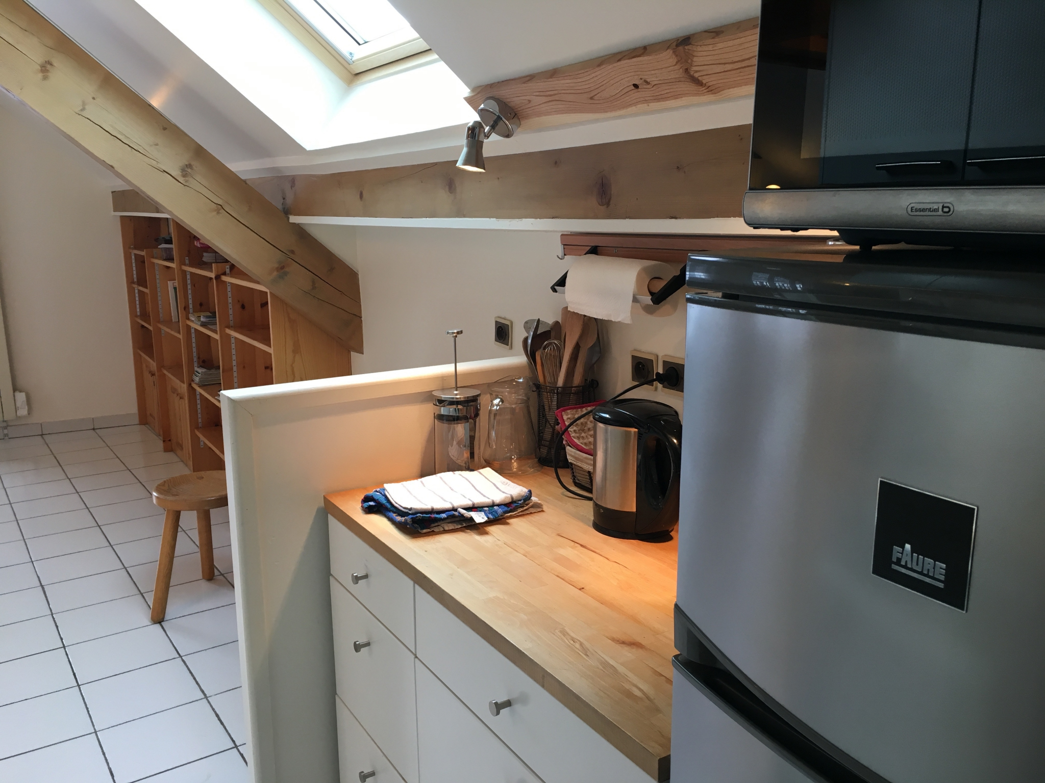 Kitchen area with fridge freezer