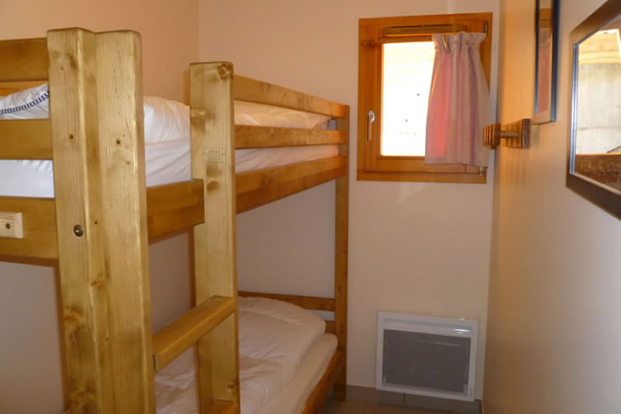 The small bunk bedroom has full size bunk beds