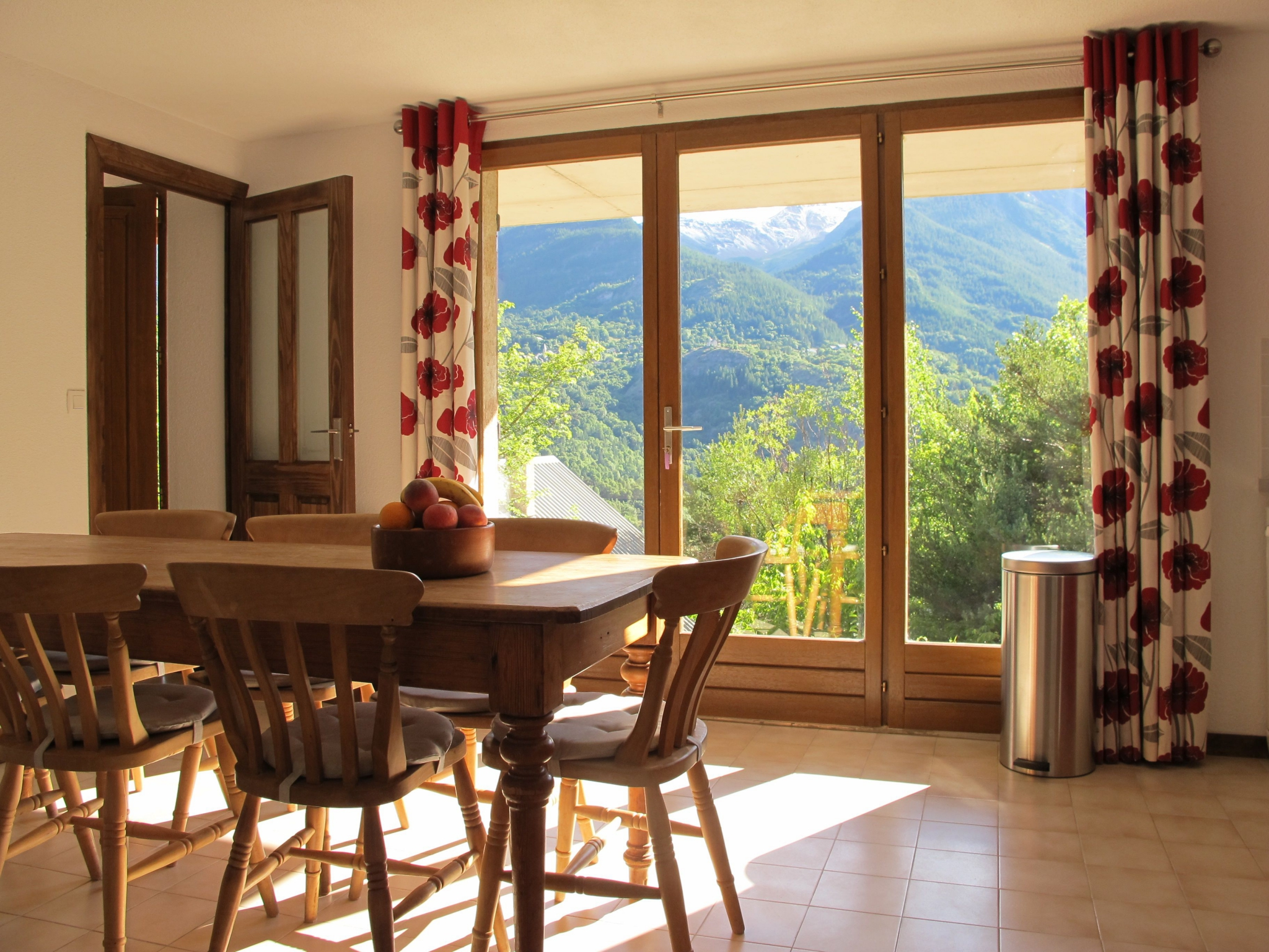 Kitchen with french windows to magnificent view