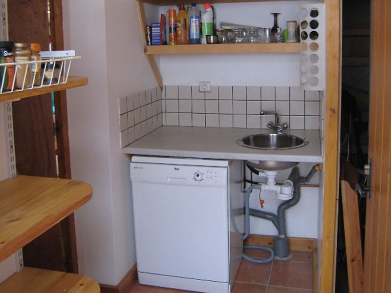 The dishwasher is housed in the utility room